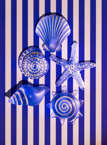Study in blue Blue Pattern Close-up Indoors  No People Striped Metal Design Shape Studio Shot Colored Background White Color Hanging Backgrounds Silver Colored Still Life Full Frame Side By Side Wall - Building Feature Blue Background Ornate