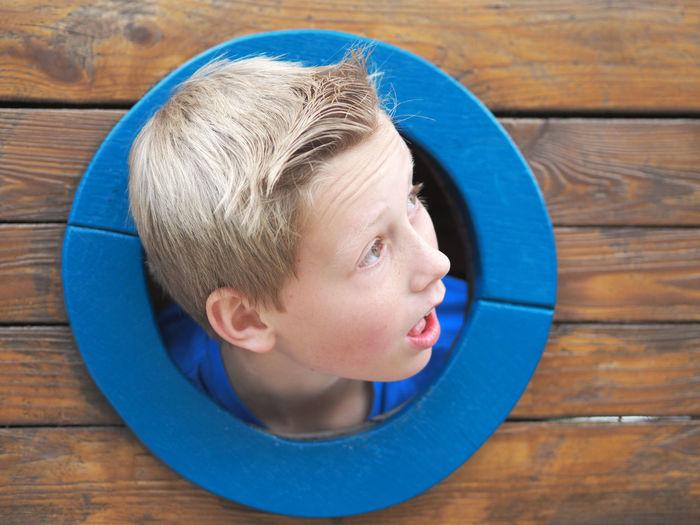 funny boy Amazed Blond Boy Child Childhood Fun Funny Kid Playground Porthole Suprise Suprised Teenager Young