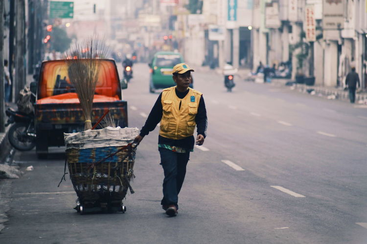 People activity.. Occupation Full Length One Man Only Adult Transportation People One Person Only Men Day Men Adults Only Outdoors City Oil Pump EyeEmNewHere Real People EyeEm Selects City Life