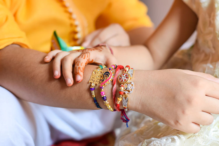 rakhi celebration Indian Culture  Midsection Human Hand Hand Women Bracelet Real People Focus On Foreground Human Body Part Close-up Lifestyles Two People Indoors  People Togetherness Bonding Leisure Activity Front View Rakhi Raksha Bandhan Festival Ethnic Siblings Family Love Human Connection