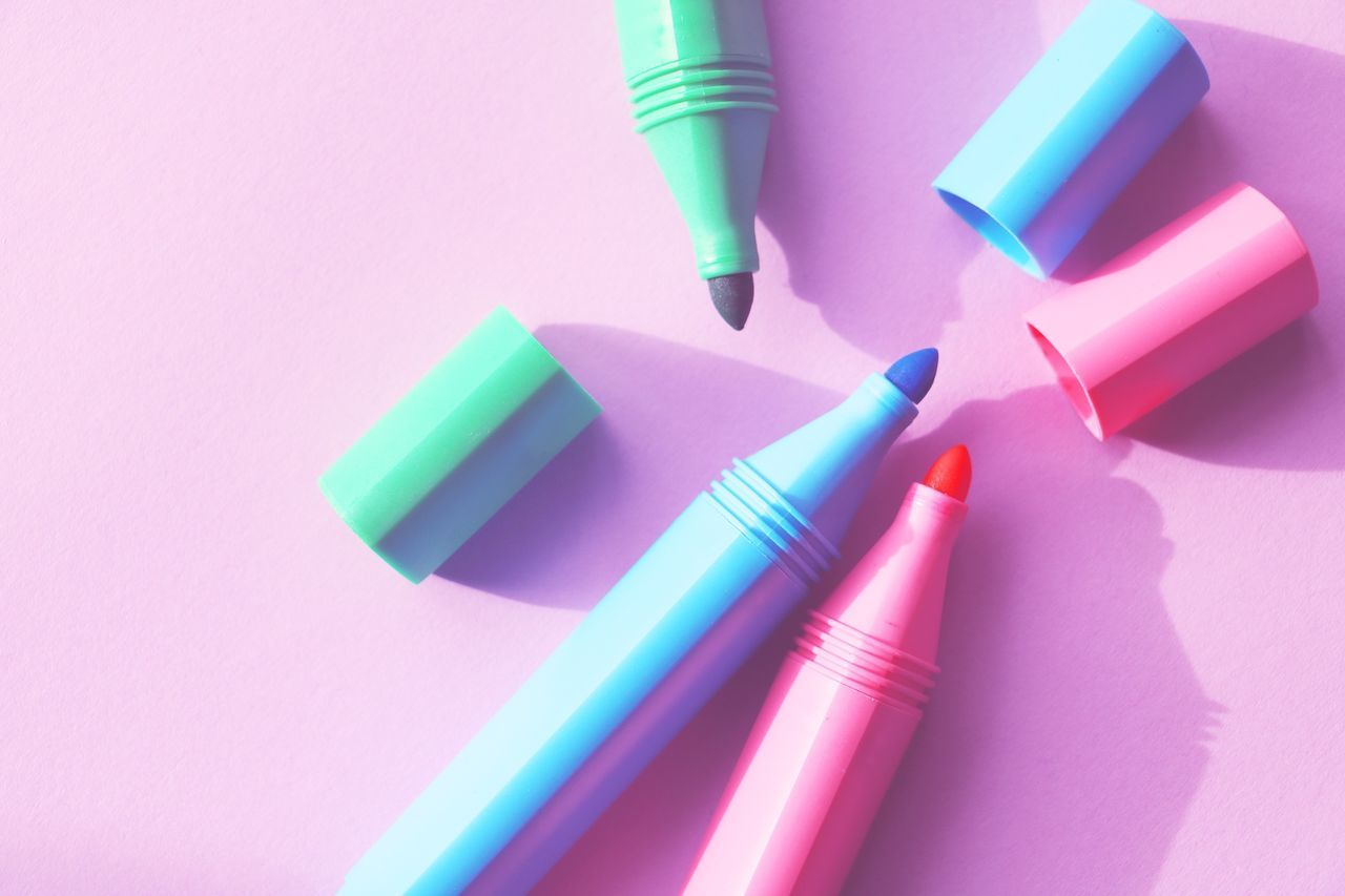 High angle view of colorful felt tip pens on table