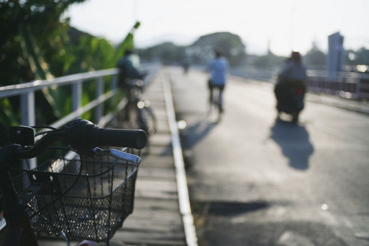 Transportation Bicycle Focus On Foreground Mode Of Transportation Day Sunlight Nature Land Vehicle Real People Basket Lifestyles Incidental People Shadow Outdoors City Bicycle Basket People Railing Road Walking Unrecognizable Person