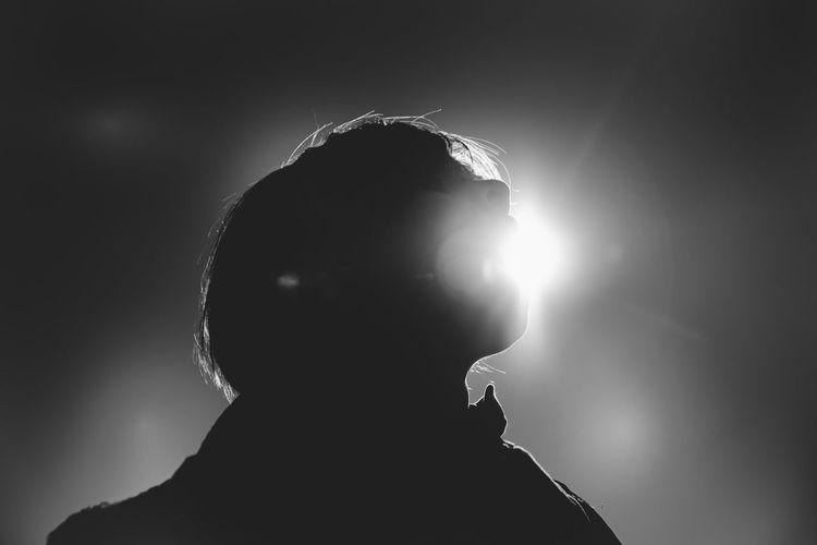 Portrait of silhouette man against illuminated light