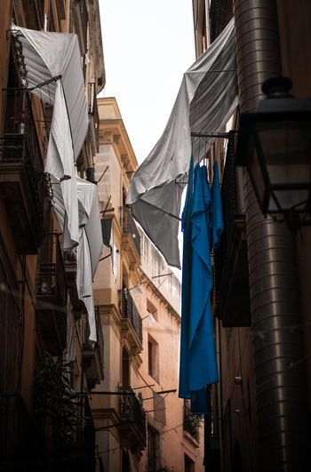 Laundry day in the streets of Barcelona, Spain. Barcelona Catalunya City Laundry Laundry Day SPAIN Alley Architecture Building Building Exterior City Clothing Day Drying Fresh Fujifilm Fujifilm_xseries Laundry Low Angle View No People Street Street Photography Streetphotography Textile Washing