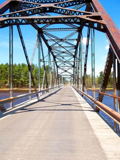 The old steel bridge over the river. Architecture Bridge Bridge - Man Made Structure Bridge View Built Structure Cantilever Bridge Cantilever Truss Bridge Connection Day Days Gone By No People Old Bridges Old Steel Bridges Outdoors Past Road Sky The Way Forward Transportation Travel Destinations Tree