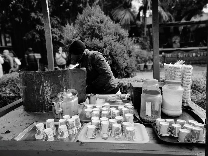 Man selling tea at market stall