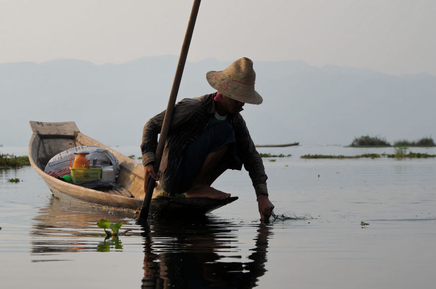 Beauty In Nature Fisherman Full Length Holding Inle Lake Lifestyles Men Mode Of Transport Mountain Nature Nautical Vessel Oar Occupation One Person Outdoors People Real People Sky Standing Transportation Water Waterfront Wooden Raft Working
