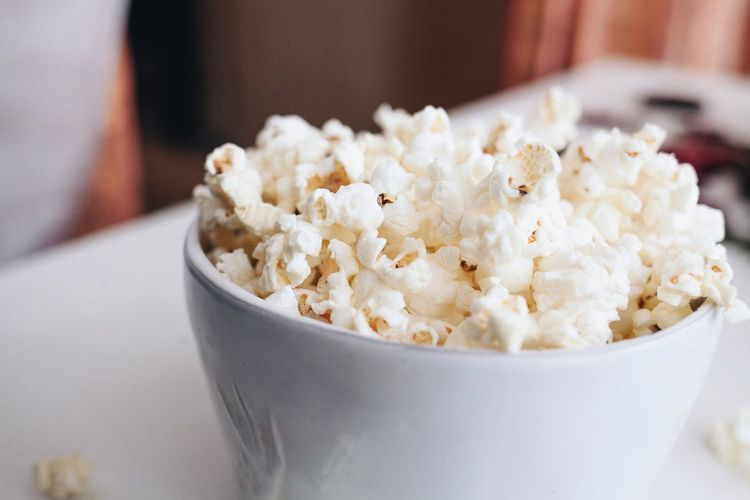 Close-up of popcorns in bowl on table