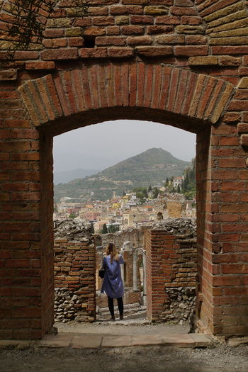Arch Architecture Built Structure Day Outdoors One Person Viewpoints View From The Top City Taormina Taormina, Sicily 🇮🇹 Travel Destinations Tourism Tourism Destination Sicily, Italy Sicily ❤️❤️❤️ Tourists Ruins Architecture The Old City Brick Wall Archaeological Sites