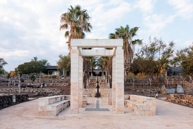 Decorative arch and bench in National Park in Capernaum (Cafarnaum). Arch Architecture Beautiful Bench Brown Colorful Construction Corridor Day Decor Decorative Elegant Garden History Metal Nature No People Object Old Outdoors Park Tree Vintage Walkway Wood
