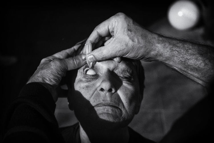 The Photojournalist - 2018 EyeEm Awards Adult Close-up Contemplation Cure Dark Emotion Eye Finger Focus On Foreground Front View Hand Headshot Holding Hopelessness Human Body Part Human Face Human Hand Lifestyles Men People Portrait Real People Senior Adult Senior Women The Portraitist - 2018 EyeEm Awards HUAWEI Photo Award: After Dark A New Beginning This Is Natural Beauty A New Perspective On Life Human Connection International Women's Day 2019