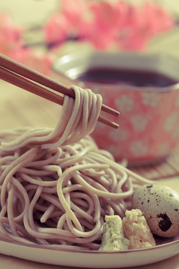 Close-up of noodles in bowl on table