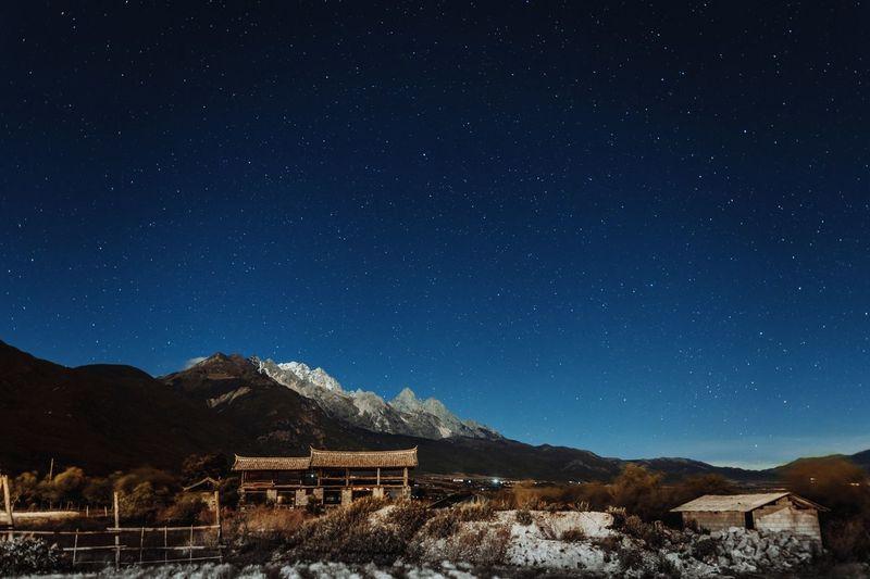 玉龙雪山星空 Star - Space Astronomy Night Sky Space Architecture Mountain Galaxy Scenics - Nature Star Built Structure Beauty In Nature Building Exterior Star Field No People Nature Tranquility Infinity Building Blue EyeEmNewHere