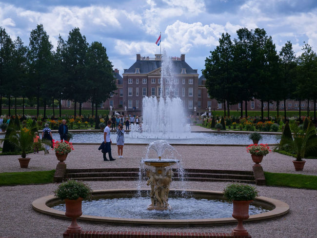 Royal gardens palace het Loo. Water Fountain Spraying Splashing Motion Tree Architecture Cloud - Sky Built Structure Drinking Fountain Government Sky Travel Destinations Outdoors Day People Politics And Government Adults Only Adult Royalgardens Royalpalace Hetloo Your Ticket To Europe