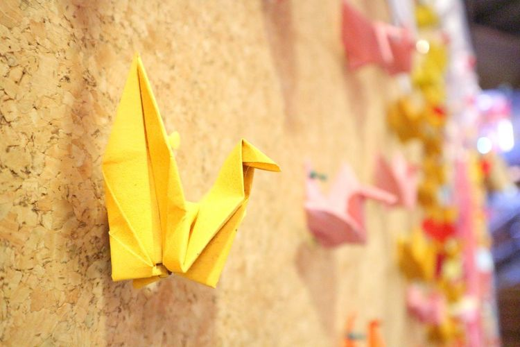The yellow paper birds on the board. Green Paperbirds Yellow Paper Yellow Business Close-up Paper Boat Toy Animal Luck