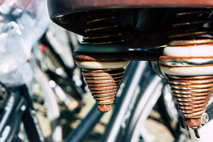 Close-up of bicycle parked on metal