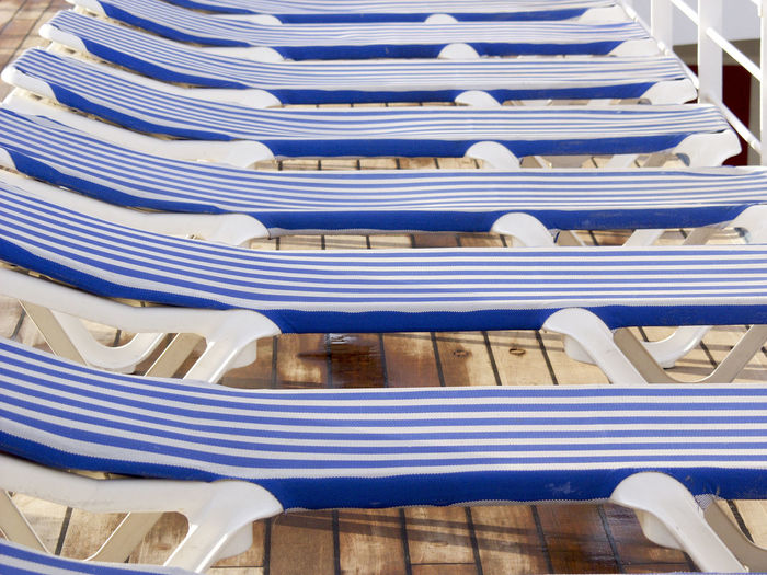 Row Of Lounge Chairs On Boat Deck