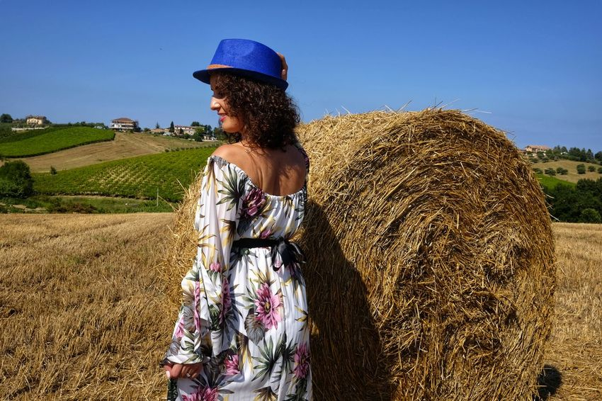 beautiful woman between round bales Hat Woman Adult Agriculture Bale  Beauty In Nature Clothing Day Farm Farmer Field Hay Land Landscape Leisure Activity Lifestyles Nature Outdoors Plant Pretty Real People Rural Scene Sky Standing