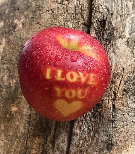 Food Food And Drink Wood - Material Red Fruit Freshness No People Red Freshness Healthy Eating Love Close-up Text Apple - Fruit Table Indoors  Positive Emotion Still Life Single Object Heart Shape