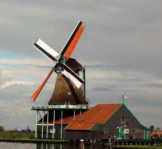 Alternative Energy Cloud Cloud - Sky Cloudy Day Development Environmental Conservation Landscape Nature No People Outdoors Overcast Renewable Energy Rural Scene Sky Traditional Windmill Weather Wind Power Wind Turbine Windmill Windmills Of Holland