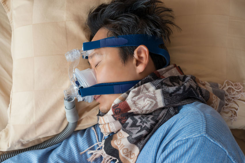 Man and cpap mask.Middle aged man with obstructive sleep apnea symptoms sleeping well on his right side by wearing cpap mask,healthcare concept. Choking Continuous Positive Airway Pressure Hospital RIGHT SIDE Snoring Tube Close-up Concept Cpap Headshot Healthy Lifestyle High Angle View Mask Obstructive Sleep Apnea Real People Senior Men Sleep Apnea Sleeping Symptoms