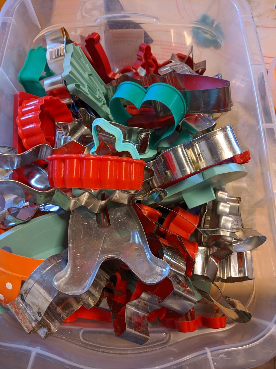large group of objects, no people, indoors, multi colored, close-up, still life, plastic, abundance, container, high angle view, choice, toy, variation, red, wrapped, metal, sweet food, candy, collection, day, plastic bag