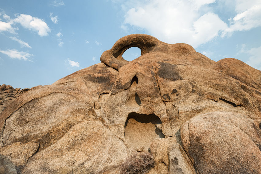 Eye on the hill. Arid Climate Beauty In Nature Cloud - Sky Day Low Angle View Mountain Nature No People Outdoors Physical Geography Rock - Object Scenics Sky Tranquil Scene Tranquility Travel Destinations