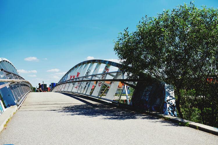 View of bridge against cloudy sky