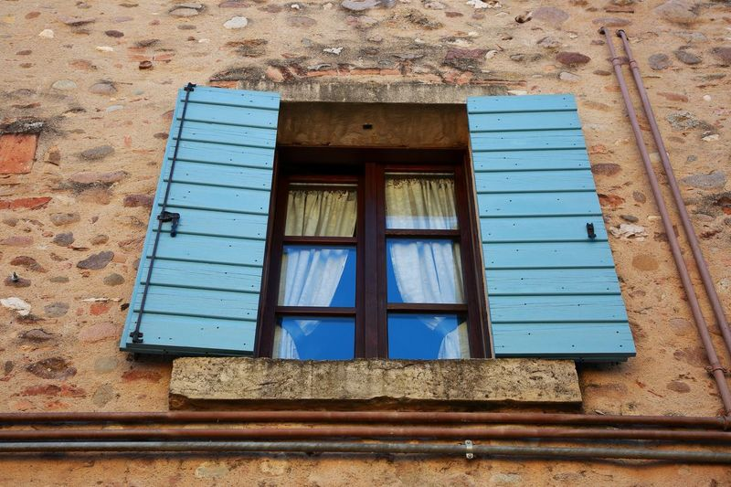 At the window Old Curtains Italy Travel Destinations EyeEm Best Shots EyeEmBestPics Inspirational Bestoftheday Photooftheday Canon5Dmk3 Windowshade Moments Bluewindow History TOWNSCAPE View Window Built Structure Architecture Building Building Exterior Day No People Outdoors Blue Geometric Shape House