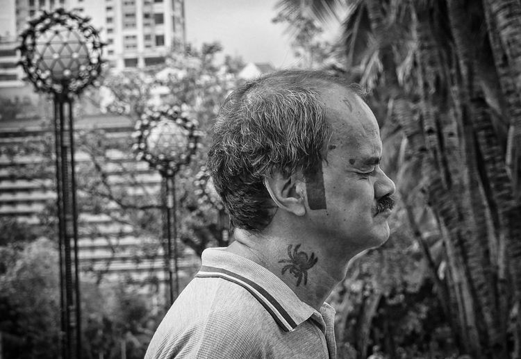 Meditation. Circle Confidence  Picturing Individuality Creativity Focus On Foreground Meditation Person Relaxation Round Serious Sideburns Solo Streetphotography