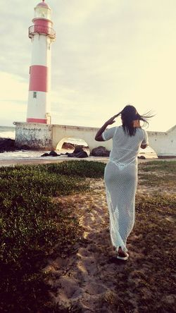 Lost In The Landscape LostInParadise One Person Farol Cloud - Sky Water Lighthouse Nature Adult Sky Children Only Outdoors Grass Day People One Boy Only Child Brunette Teamwork Happiness One Woman Only Morena ❤ Two People Body & Fitness