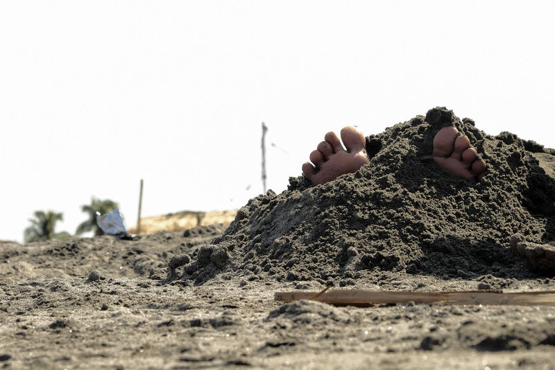 Clear Sky One Person Sky Land Sand Nature Selective Focus Real People Day Human Body Part Copy Space Hand Human Hand Beach Body Part Dirt Leisure Activity Close-up Outdoors Finger Human Foot Surface Level Feet The Art Of Street Photography