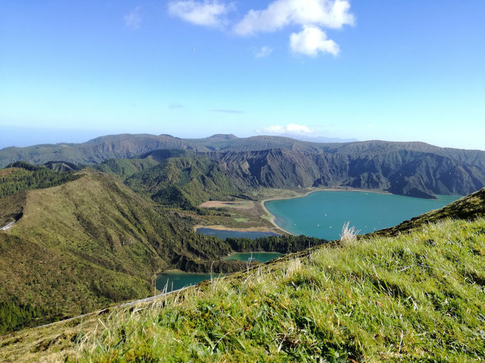 Beauty In Nature Blue Scenics Nature Mountain Tranquil Scene Tranquility Sky Growth Landscape Outdoors No People Water Tree Day Lush - Description Beauty In Nature Nature Freshness Azores Travel Contrast Lake Lake View Lakeside