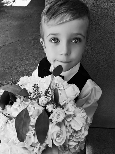 Flowers holder. Child Childhood Portrait Human Hand Flower Looking At Camera Close-up