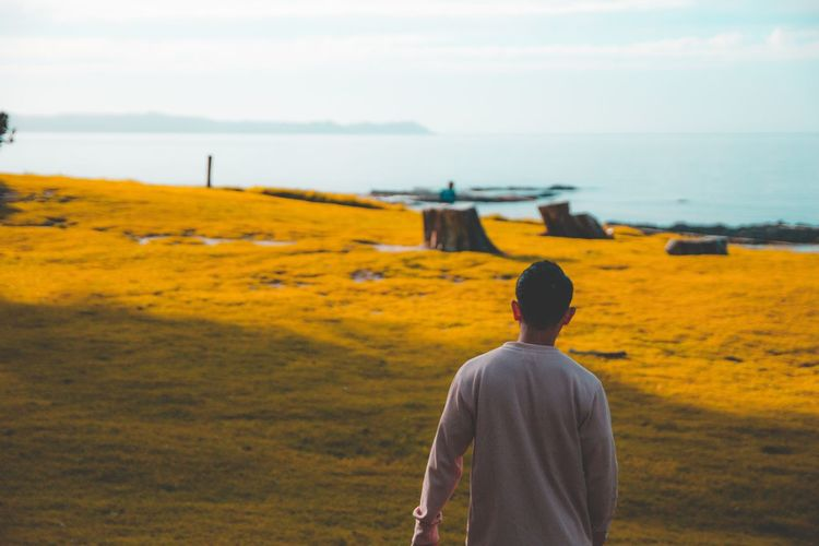 Over. Billboard Photooftheday Model Colors EyeEm Selects Men Yellow Standing Rear View Sky Landscape Hiker Horizon Over Water Coast Scenics Idyllic Tranquil Scene Groyne Seascape Sea Ocean Wave Rushing Bale  Farmland Shore Cultivated Land Agricultural Field Fall Calm