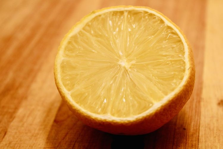 Close-up of orange slice on table