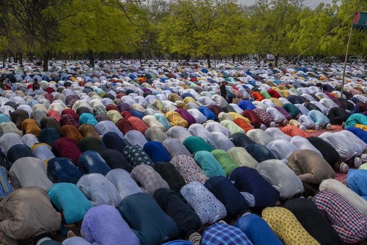 Men praying outdoors