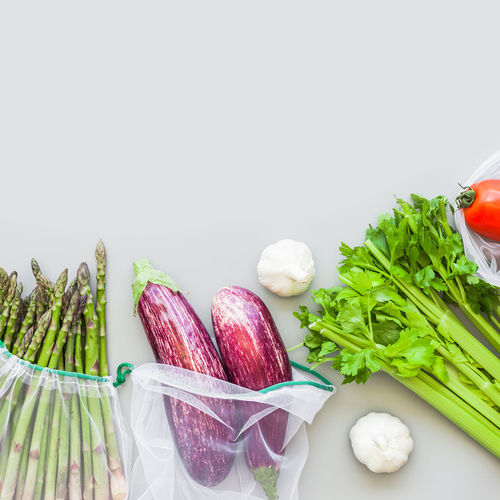 Vegetables in plate against white background