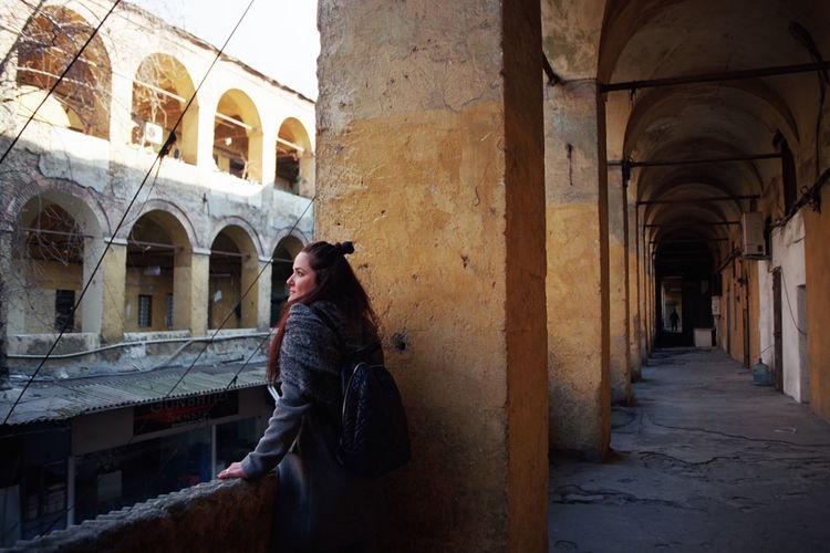 Woman Standing In Old Corridor
