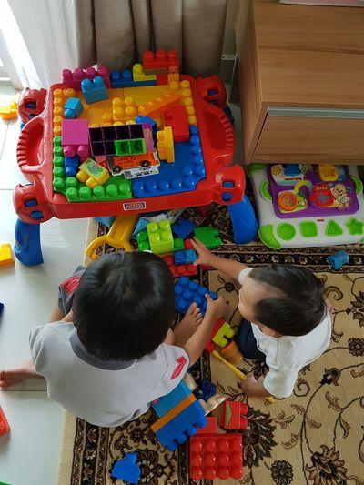 Playing together. Playtime Siblings Building Blocks Sibling Rivalry Sibling Love
