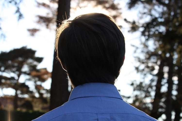 Rear view of boy against sky