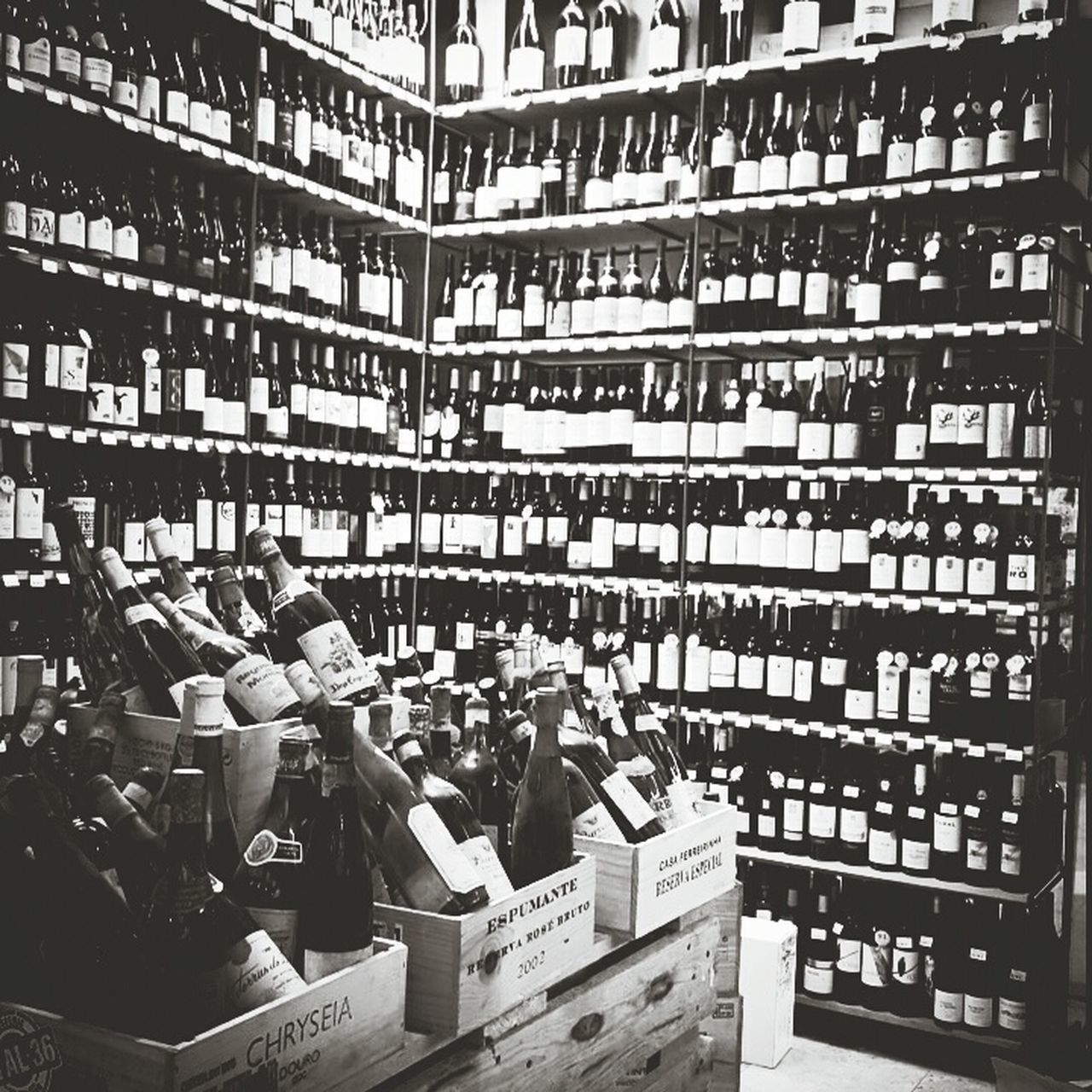 shelf, large group of objects, retail, bottle, indoors, abundance, library, choice, men, bookshelf, business, real people, women, day, architecture, supermarket, people, adult