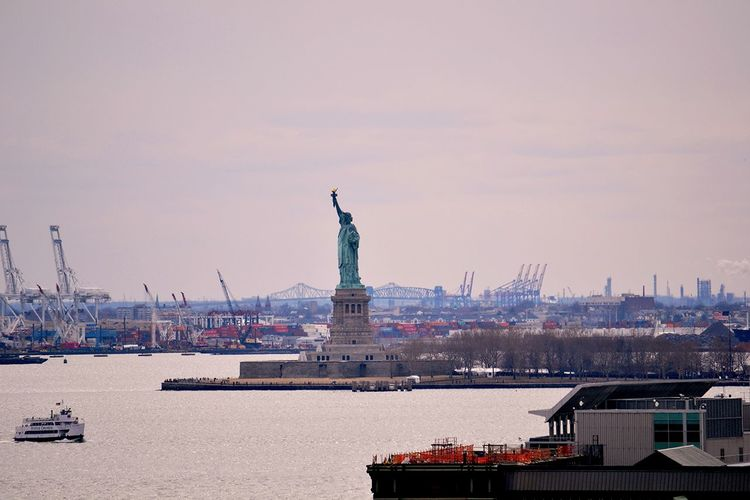 Scenic view of statue of liberty and construction work