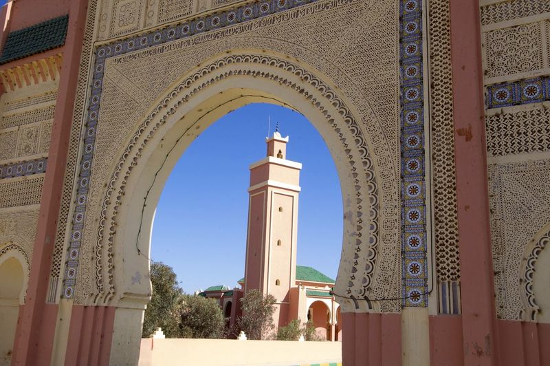 Entry arch & mosque in Rissani, Morocco. Entrance Entrance Gate Gate Morocco MoroccoTrip North Africa Rissani Africa Arch Architecture Building Building Exterior Built Structure Day Minaret Mosque Relegion Travel Travel Destinations