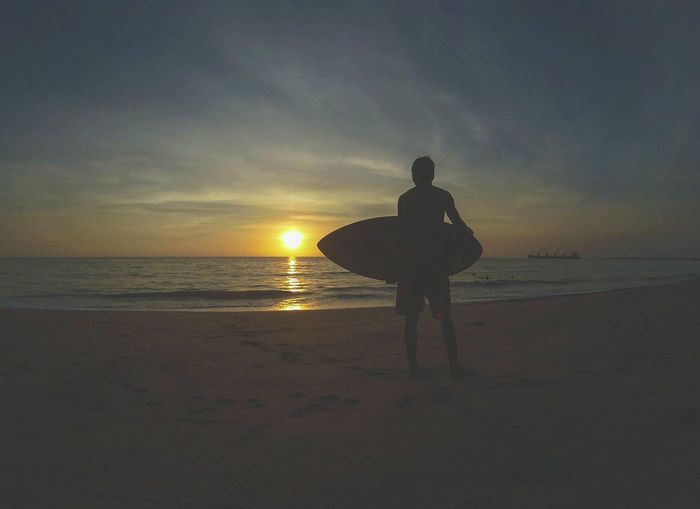 'Never let the best waves in life go by.'😎⛅☁ Beach Sea Sunset Silhouette Sand Water Summer Travel Destinations The Great Outdoors - 2017 EyeEm Awards Nature 2017 Eyeem Awards Landscape Art Is Everywhere Botolanzambales Sky Eyeem Philippines Travel Photo Photography Darkness And Light Itsmorefuninthephilippines Philippines Cloud - Sky Goprophotography Live For The Story
