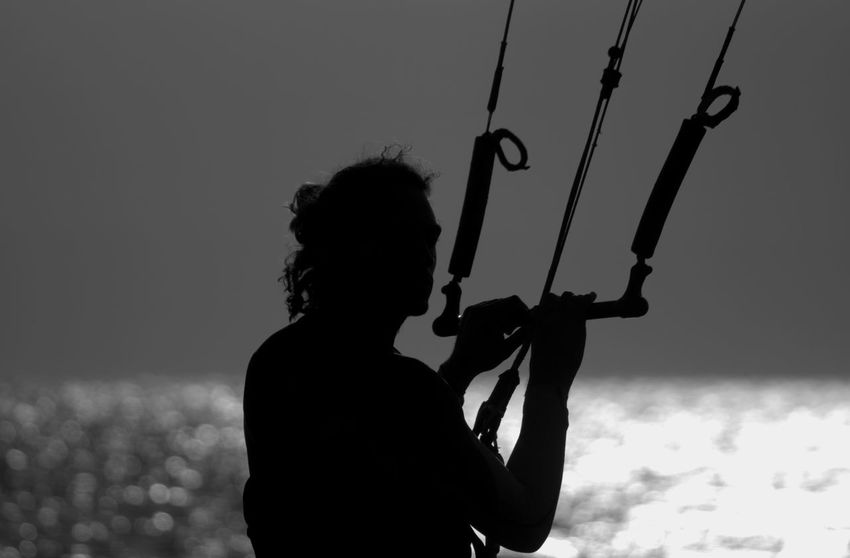 Black And White Blackandwhite Carefree Fun Holding Kitesurfing Leisure Activity Lifestyles Light And Shadow Monochrome Outdoors Real People Seaside Silhouette Sunset Surf's Up Live For The Story