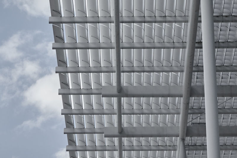 Low Angle View Of Roof Against Clouds
