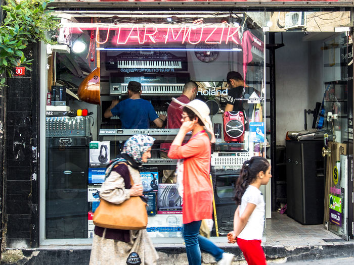 Shop for electronic musical instruments and passers-by in Karakōy, Istanbul City Electronic Music Group Of People Musical Instrument Retail  Shopping Store Street