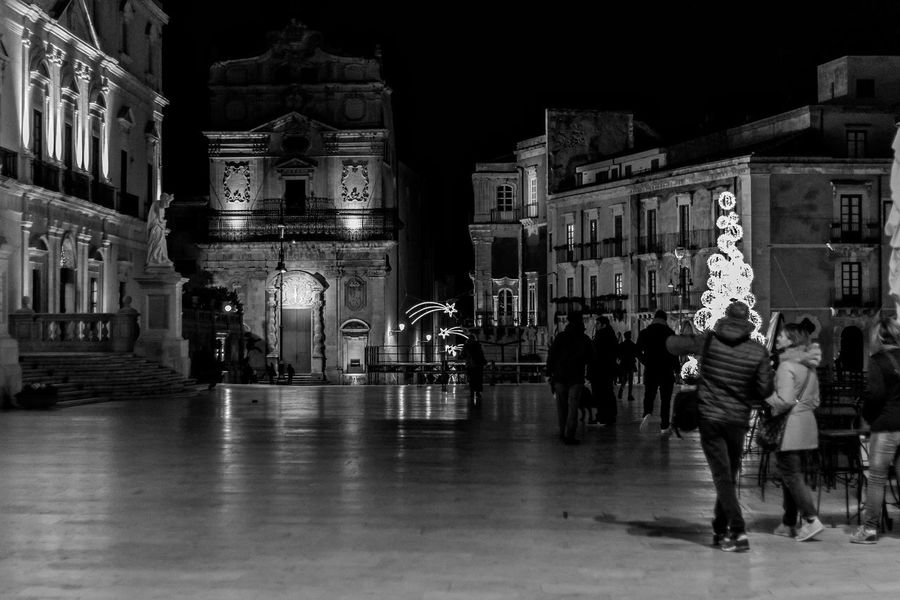 Christmas atmosphere Historical Center Blackandwhite Blackandwhite Photography Beautiful Place World Heritage Sicily Siracusa Duomo - Ortigia Piazza Duomo Siracusa Building Exterior Architecture Night Built Structure Real People Large Group Of People Outdoors Illuminated People EyeEm Ready   EyeEmNewHere