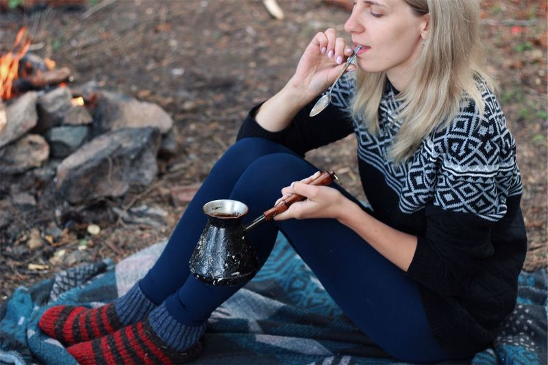 Coffee with smoke EyeEm Selects Women Sitting Adult Young Adult Lifestyles Young Women One Person Casual Clothing Leisure Activity Hair Real People Day Nature Beauty Outdoors Hand Hairstyle Focus On Foreground